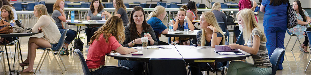 Students study and socialize in the commons area at the Stenstrom Center.