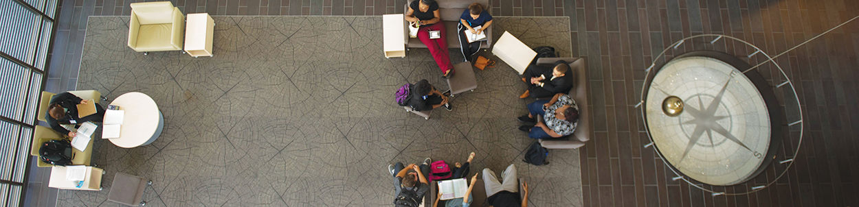 Overhead shot of students studying in the lobby of the Jacobs Center for Science and Math.