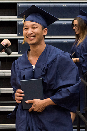 Student at graduation after receiving his diploma