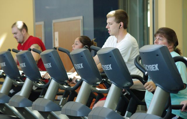 Students work out on the elliptical machines in the RVC Fitness Lab.