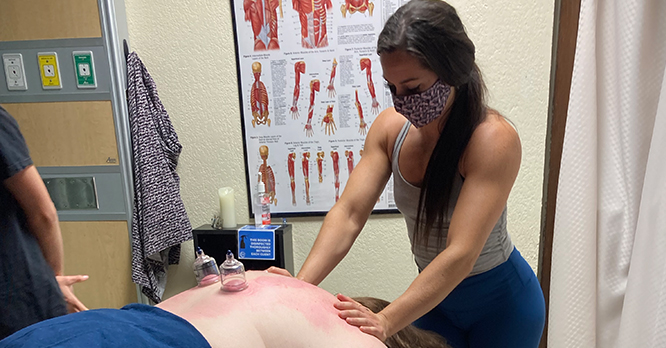 Massage Therapy Student Cupping